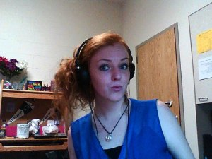 "This is an excellent example of what I assume ""White Girls Be Like"". (Note: duckface, headphones, laptop cam)"